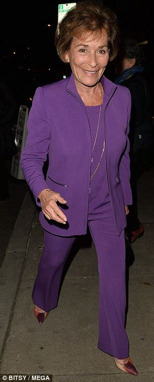 Judge Judy suits up in purple for Alan Alda 81st birthday